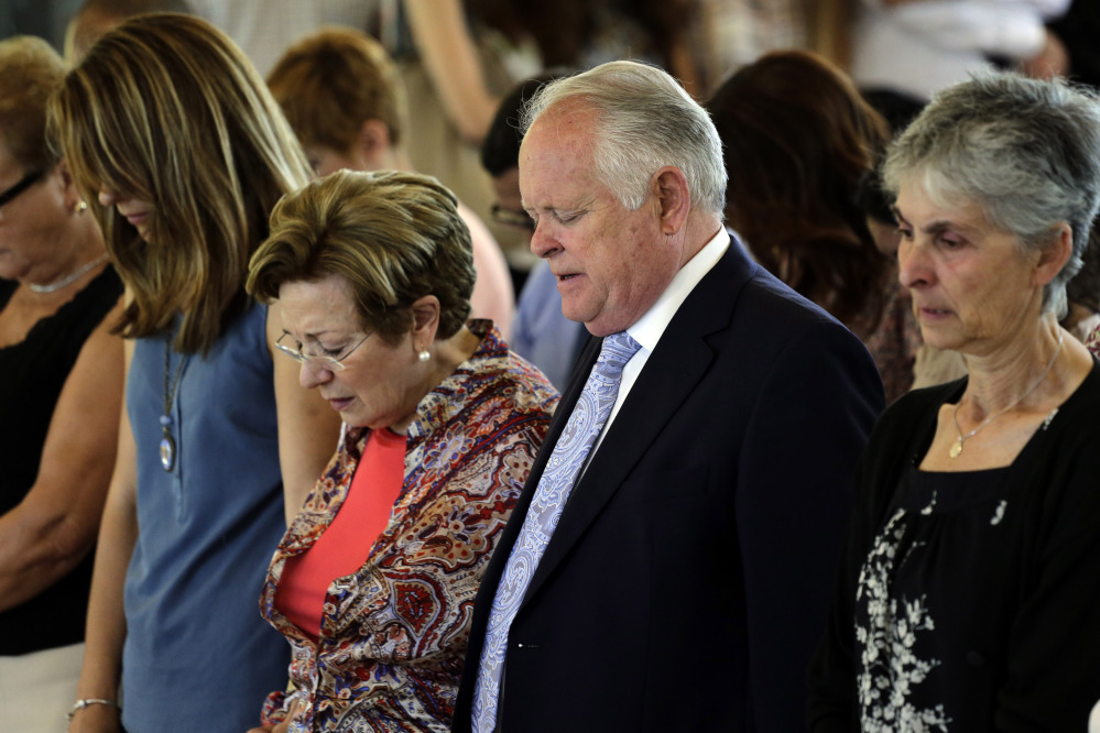 The Associated Press Robert Tansill Oliver, centre right and Maribel Calvo, the parents of Robert Oliver Calvo, a businessman who was on board of the Germanwings jet which crashed in the French Alps, pray, during a religious funeral service, in Montcada, near Barcelona, Spain, Saturday.