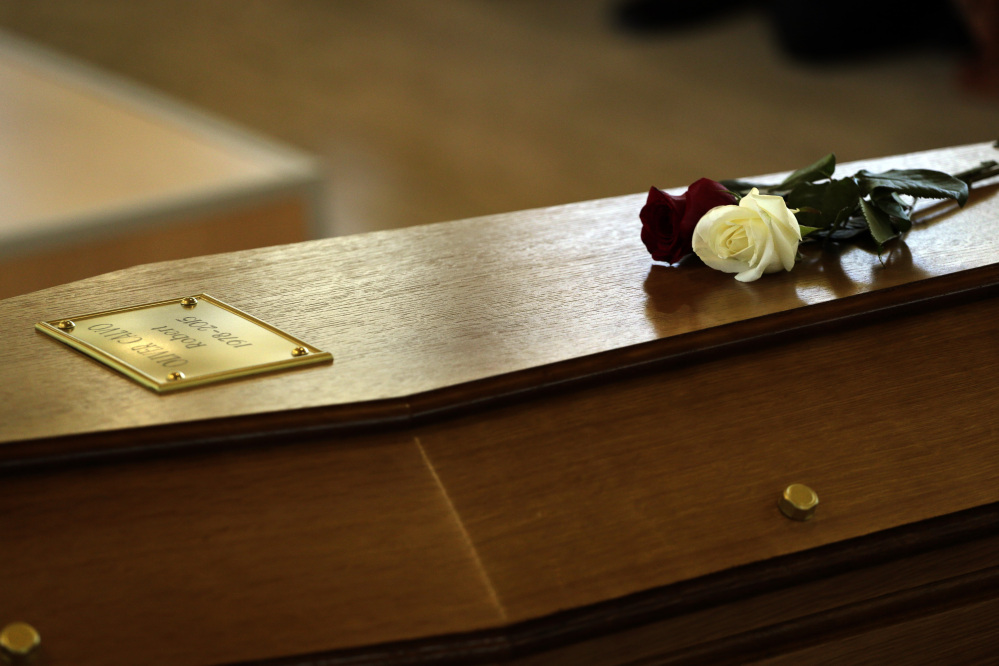 Flowers on top of a coffin with the remains of Robert Oliver Calvo, on a business trip when the Germanwings jet he was in crashed in the French Alps, during a religious funeral service in Montcada, near Barcelona, Spain, Saturday. The Associated Press
