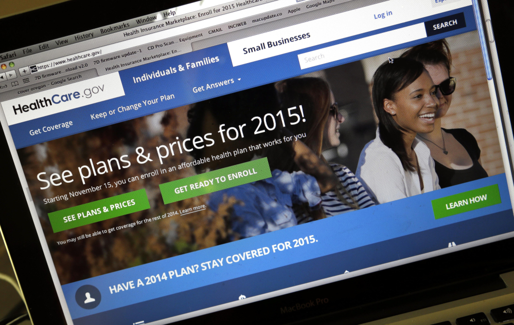 The HealthCare.gov website, where people can buy health insurance, is displayed on a laptop screen.