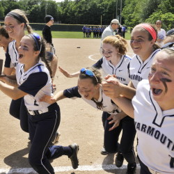 Yarmouth captain Michelle Robichaud carries the championship trophy Saturday as the Clippers celebrate their Class B softball state championship after a 7-5 win against Hermon.