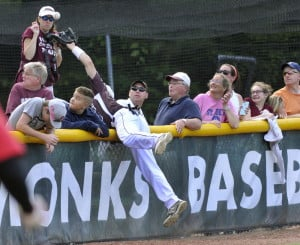 Greely's Chaz Reade leans into the crowd to make catch a foul ball. Reade also contributed with his bat, hitting a double in the second inning as the Rangers scored six times to take a 6-0 lead.