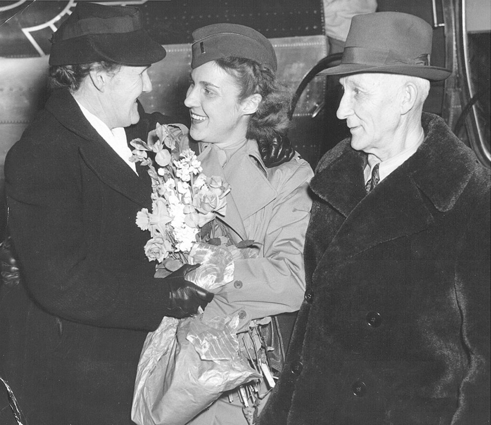 Lt. Alice M. Zwicker reunites with her parents in March 1945 in Bangor.