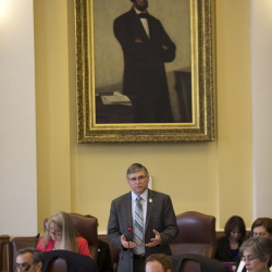Sen. Chris Johnson, D-Lincoln County, discusses legislation at the State House Tuesday, when the House and Senate took up the budget compromise.