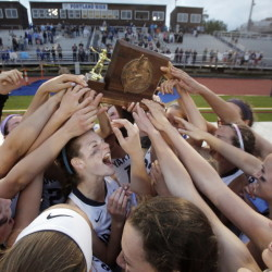 Been there, done that, and so happy to do it again as Gretchen Barbera, center, and the rest of the Yarmouth girls' lacrosse team celebrate their second straight Class B championship by beating Kennebunk. Gregory Rec/Staff Photographer