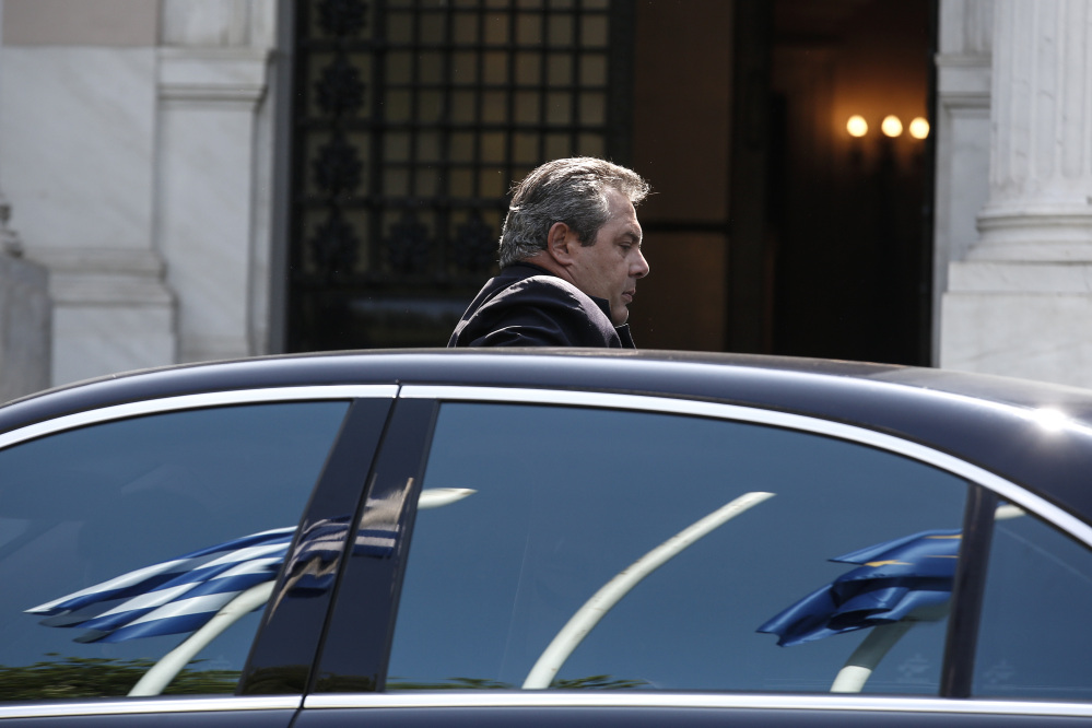 Greece's Defense Minister Panos Kamenos arrives for a Cabinet meeting at the Greek prime minister's office in Athens on Sunday.
