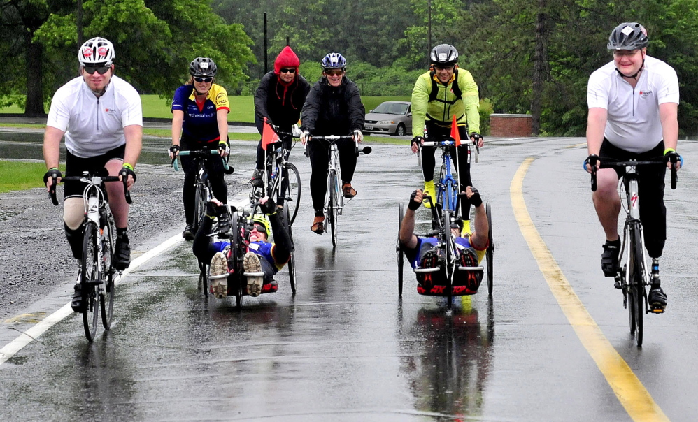 Team Maine Adaptive heads out on their Trek Across Maine. In front from left are Patrick Brown of Pittsfield, Larry Nadeau and Kenny Young of Newry and Corey Hamilton of St. Albans.