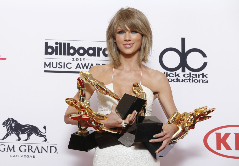 "Taylor Swift, shown with her multiple Billboard awards, wrote in a open letter to Apple, ""We don't ask you for free iPhones. Please don't ask us to provide you with our music for no compensation."""