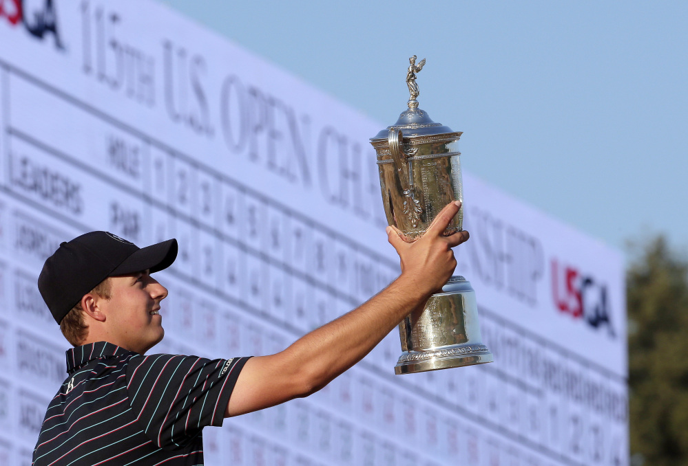 Jordan Spieth poses with the trophy after winning the U.S. Open on Sunday at Chambers Bay in University Place, Wash.