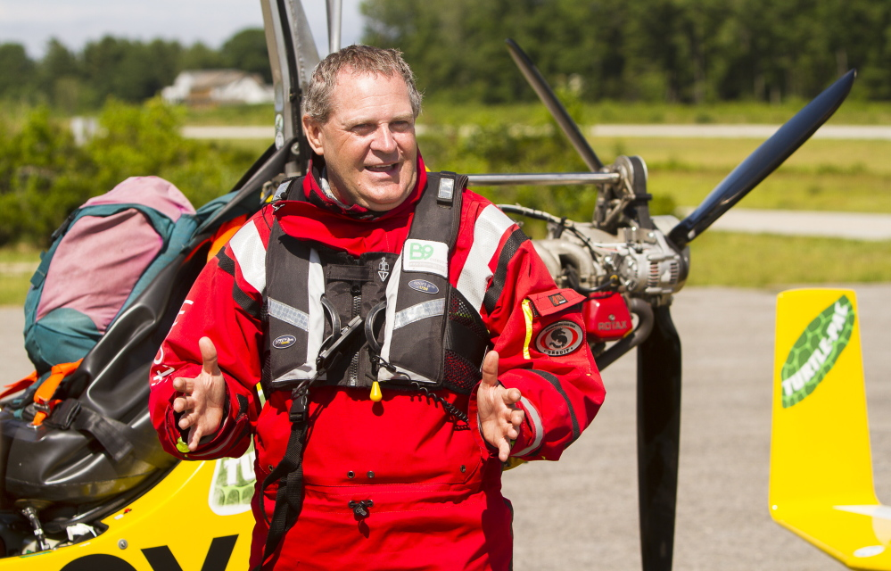 Norman Surplus answers questions after landing his one-man aircraft at Biddeford Municipal Airport on Monday.  Carl D. Walsh/Staff Photographer