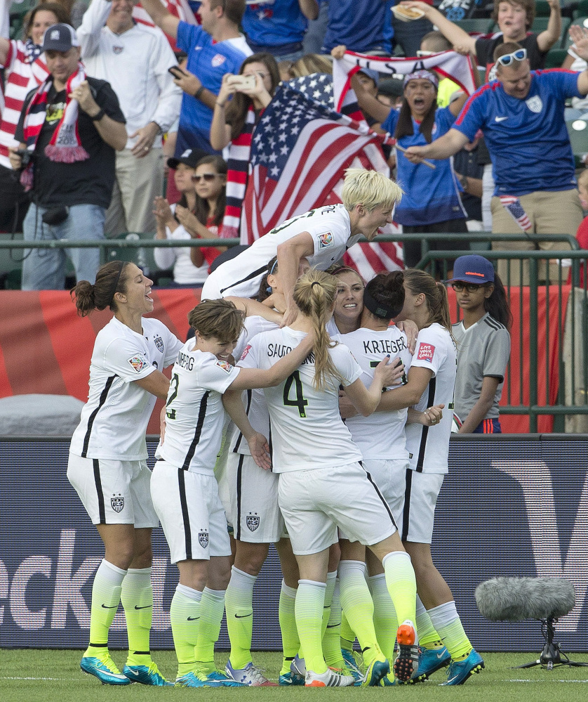 The U.S. team celebrates a goal against Colombia in the second half of Monday's 2-0 win in the Women's World Cup tournament.