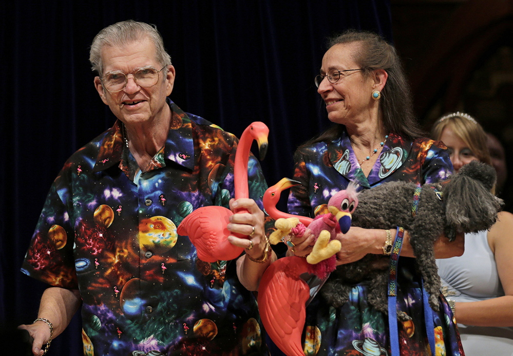 Don Featherstone, 1996 Ig Nobel Prize winner and creator of the plastic pink flamingo lawn ornament, poses with his wife, Nancy, in 2012, while being honored as a past recipient at the Ig Nobel Prize ceremony at Harvard University.