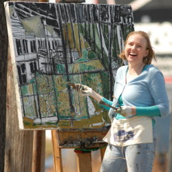 Erin McGee Ferrell of Falmouth works on a painting. For the Cellardoor piece, she painted iron gates, incorporating influences including a photo winemakers Aaron and CC Peet snapped in France and architectural features from her own Southern upbringing.