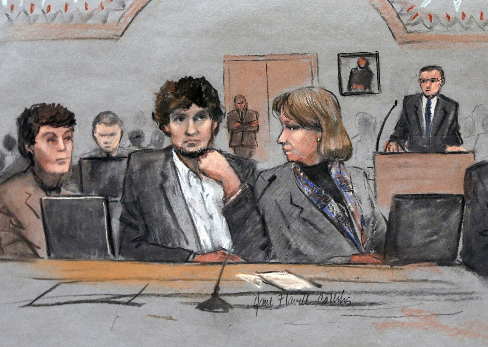 Dzhokhar Tsarnaev, center, depicted between defense attorneys Miriam Conrad, left, and Judy Clarke in March, is said to be remorseful, and if so, will have the opportunity to express his feelings during Wednesday's formal sentencing of his execution.