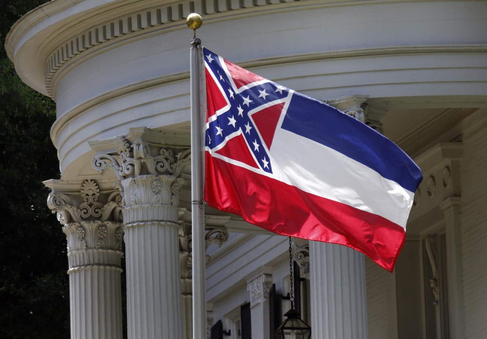 The state flag of Mississippi is unfurled against the front of the Governor's Mansion in Jackson, Miss., Tuesday, June 23, 2015. Republican Lt. Gov. Tate Reeves said Tuesday, that Mississippi voters, not lawmakers, should decide whether to remove the Confederate battle emblem from the state flag.