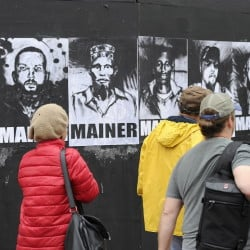"A group of eight portraits that first appeared in May on a black plywood wall next to Congress Street has become part of the citywide conversation about whether Portland should continue providing aid to asylum seekers. The black-and-white portraits show eight men and women of different ethnic backgrounds, each labeled ""Mainer."" The portraits bear the signature of Pigeon, a street artist."