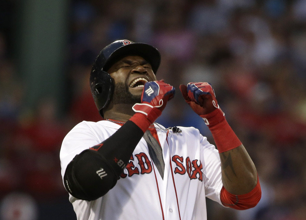 Red Sox designated hitter David Ortiz grimaces after flying out to center field to end the third inning of Tuesday night's loss to the Orioles.