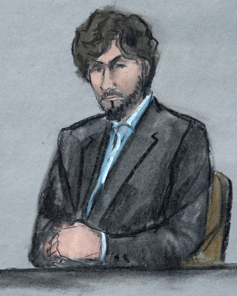 "Boston Marathon bomber Dzhokhar Tsarnaev sits as survivors and victim's family members address the court Wednesday. He told victims, ""I pray for your relief, for your healing."""