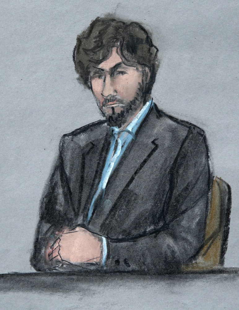 In this courtroom sketch, Boston Marathon bomber Dzhokhar Tsarnaev sits as survivors and victim's family members address the court before U.S. District Judge George O'Toole Jr. on Wednesday in federal court in Boston.