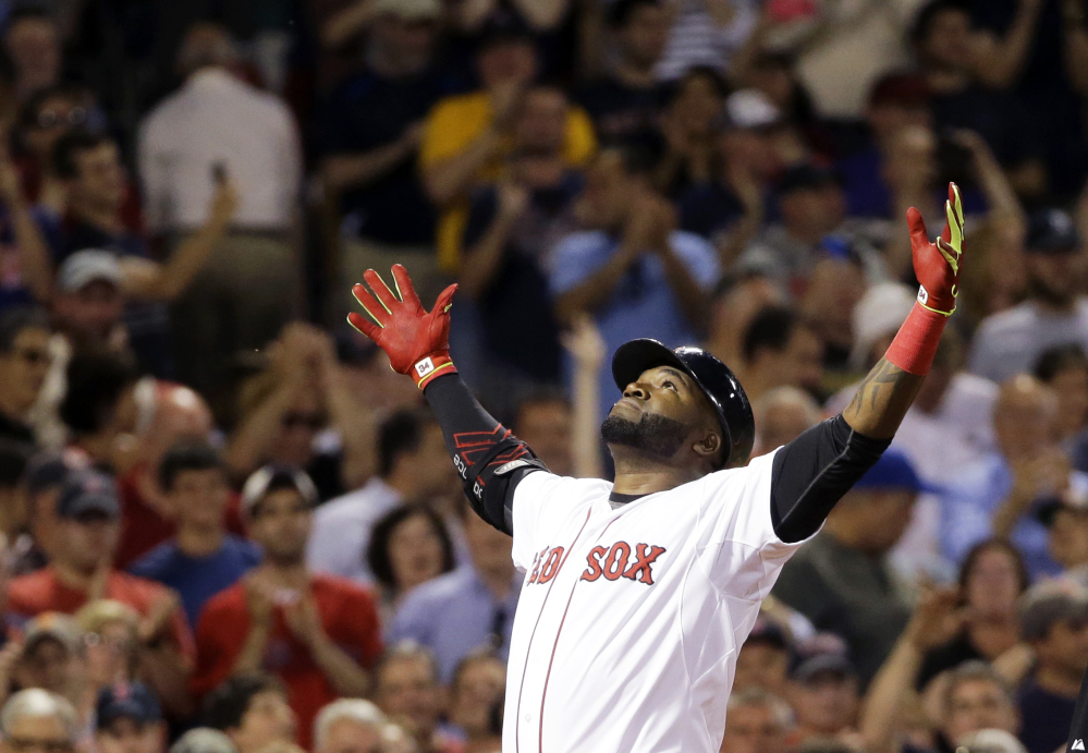 David Ortiz crosses the plate after hitting a two-run home run during Boston's sixth-inning rally. The five-run inning was enough to give the Red Sox a win over the Orioles.