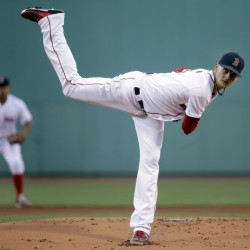 Red Sox starting pitcher Clay Buchholz delivers in the first inning of Wednesday night's game at Fenway Park. Buchholz finally got some run support and came away with a win.
