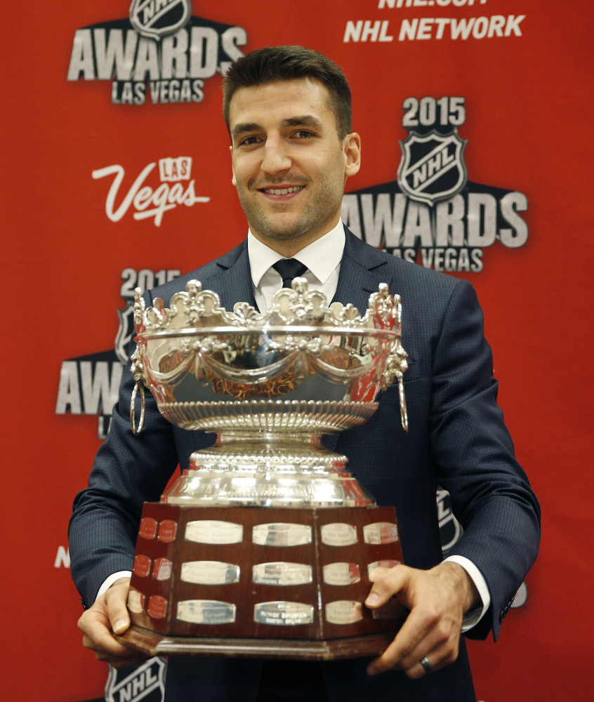 Patrice Bergeron of the Boston Bruins holds up the Frank J. Selke Trophy on Wednesday in Las Vegas. The Associated Press