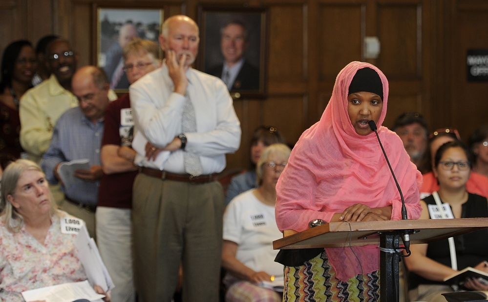 Fatuma Hussein, executive director of United Somali Women of Maine, speaks to the Portland City Council hours before it voted on the budget.