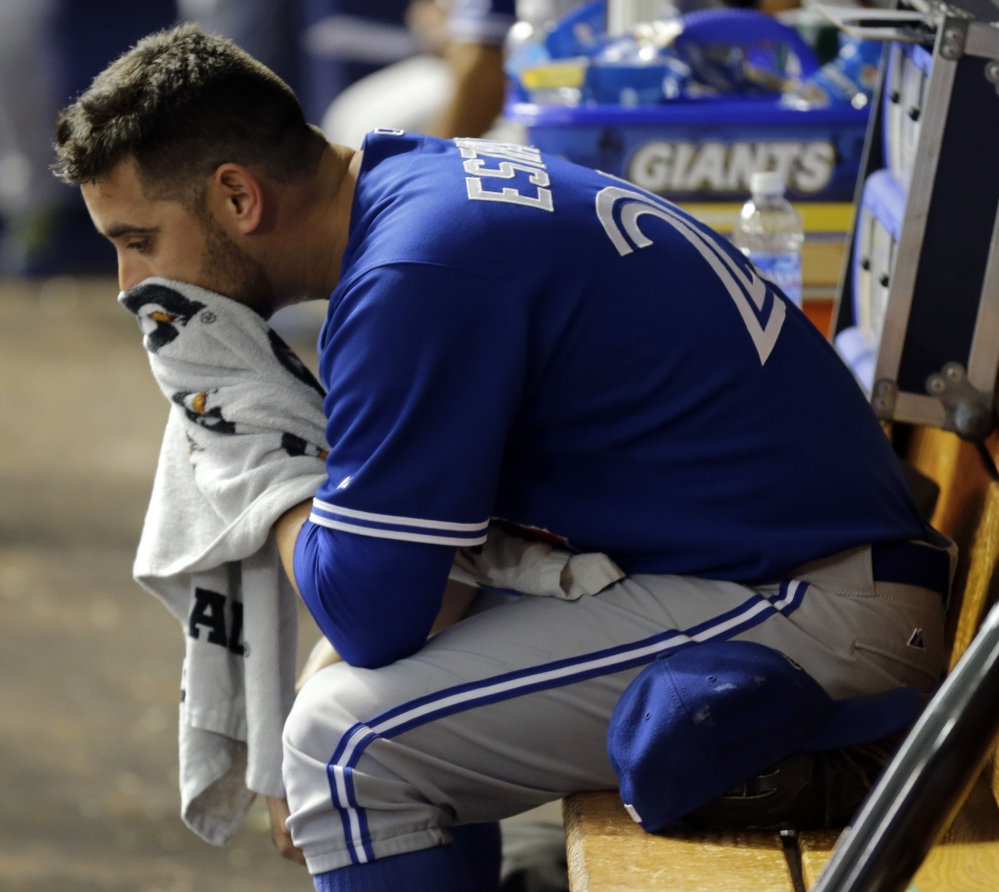 Toronto's Marco Estrada lost a perfect game with one out in the eighth on Wednesday and did not get a decision as the Blue Jays won 1-0 in the 12th.