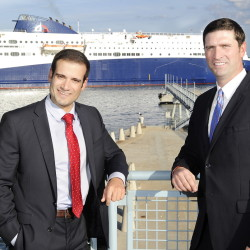 Nova Scotia legislator Zach Churchill, left, and Geoff MacLellan, Nova Scotia minister of transportation, await the Nova Star as it comes into Portland Harbor and docks at the Ocean Gateway Ferry Terminal on Thursday.