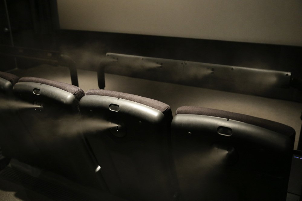 Motion seats that sway and jostle viewers, tickle legs and spray mist are coming to more movie theaters.
