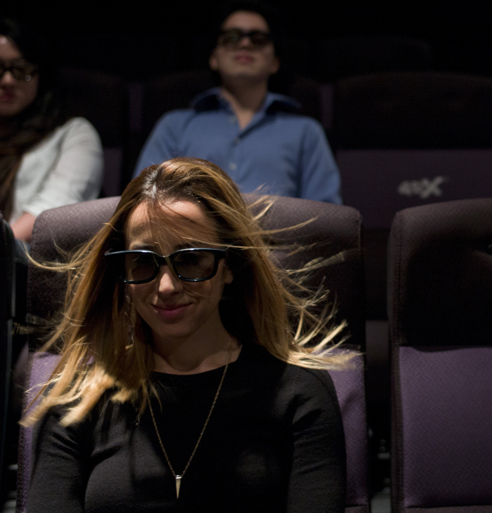 An in-theater wind effect ruffles marketing director Yassamine Wahab's hair during a demonstration at the CJ Group's 4DX Laboratory in Hollywood.
