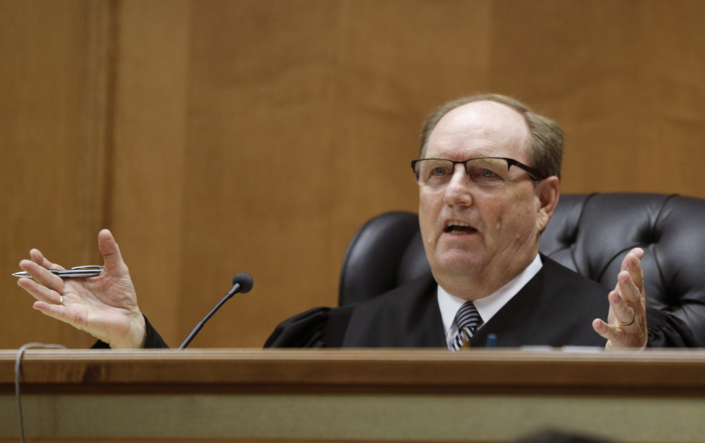 Judge Larry Hendricks asks a question of defense counsel during a hearing in Shawnee County District Court in Topeka, Kan., on Thursday. Hendricks blocked the state's first-in-the-nation ban on an abortion procedure that opponents refer to as