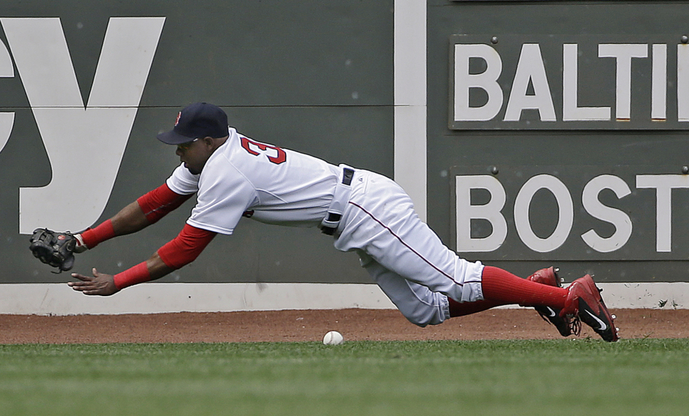 Boston Red Sox right fielder Alejandro De Aza dives but can't come up with an RBI single by Baltimore Orioles' Manny Machado in the sixth inning at Fenway Park in Boston on Thursday.