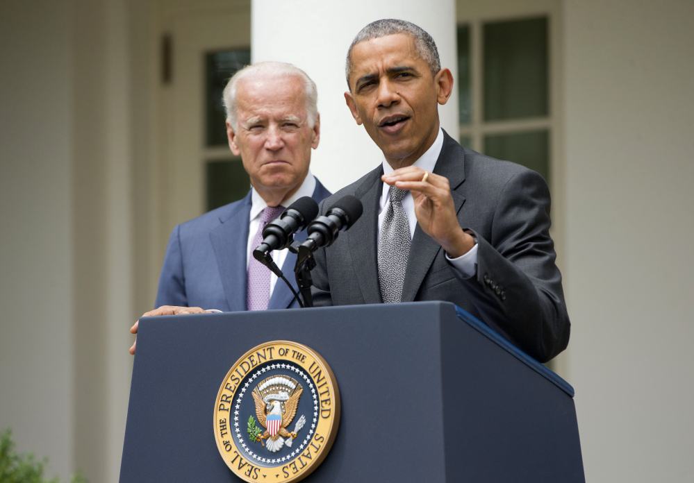 President Obama, accompanied by Vice President Joe Biden, speaks in the White House Rose Garden on Thursday after the Supreme Court ruling on the Affordable Care Act.