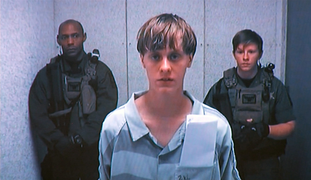 Dylann Roof appears by closed-circuit television at his bond hearing last Friday. The Associated Press