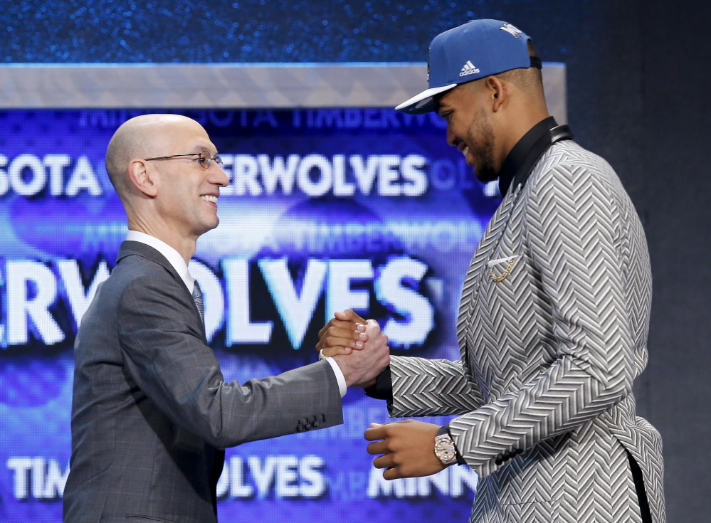 Karl-Anthony Towns, right, is greeted by NBA Commissioner Adam Silver after being announced as the top pick in the NBA draft Thursday night, taken by the Minnesota Timberwolves.