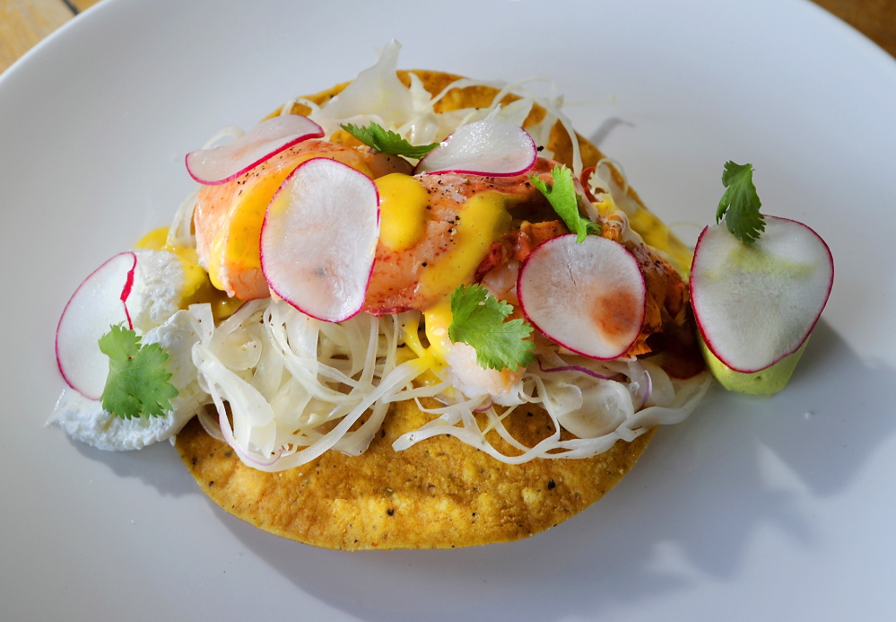 Lobster tostada with aji amarillo vinaigrette, avocado and lime crema.