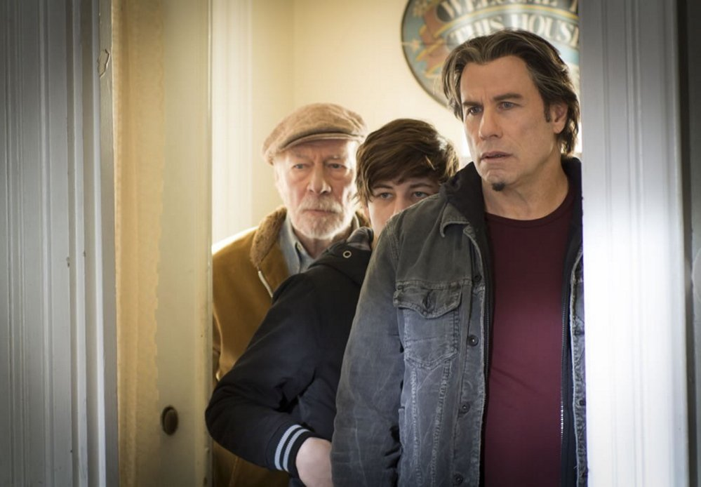 "Christopher Plummer, left, Tye Sheridan and John Travolta in ""The Forger."""