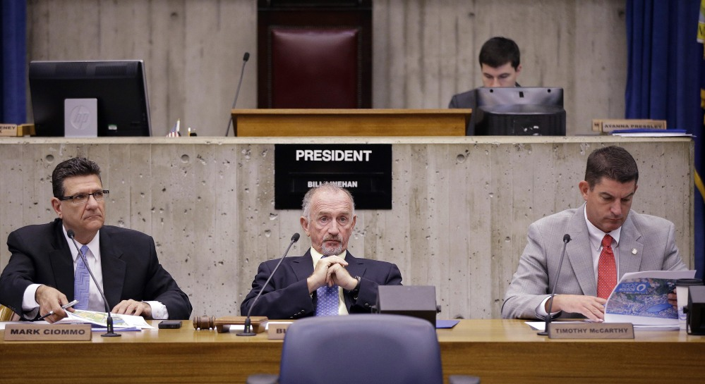 Boston City Council President Bill Linehan, center, listens to a presentation from Boston's 2024 concerning their Olympics bid during a special council committee hearing at City Hall in Boston on Friday.