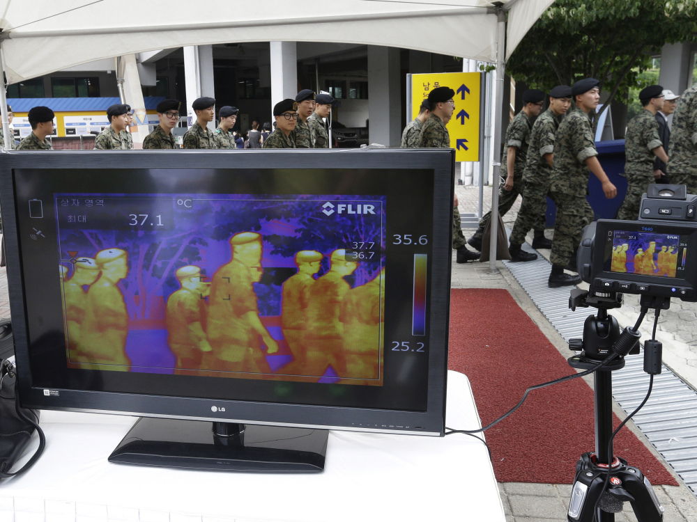 A thermal camera monitor shows the body temperature of South Korean army soldiers as a precaution against the Middle East respiratory syndrome.