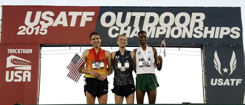 Runner-up Ben True, left, poses with winner Galen Rupp, center, and third-place finisher Hassan Mead after the 10,000 meters Thursday at the U.S. track and field championships.