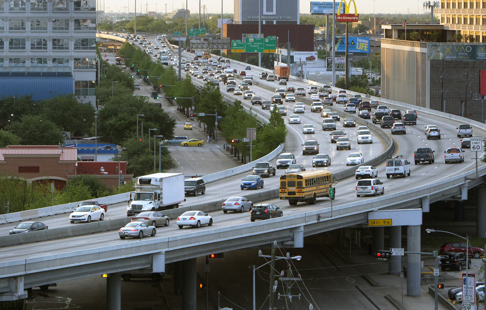 Traffic travels along a highway in Houston. While Houston plans improvements to the interstate, other cities and regions have been unwilling or unable to get ahead of a looming transportation crisis, experts say.