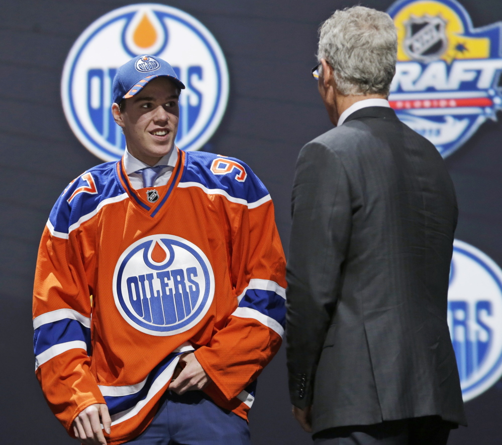 Connor McDavid, who enters the NHL with a ton of expectations, was the first choice in the draft Friday night, by the Edmonton Oilers, who are hoping to recapture the glory of the Wayne Gretzky Stanley Cup seasons.