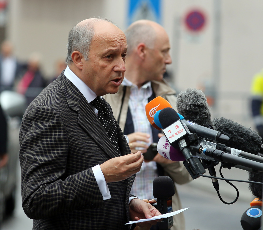French Foreign Minister Laurent Fabius talks to media as he arrives at Palais Coburg where closed-door nuclear talks with Iran take place in Vienna, Austria, on Saturday.