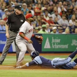 Tampa Bay Rays' Asdrubal Cabrera slides into third on a triple, next to Boston Red Sox third baseman Pablo Sandoval in the fifth inning of a baseball game Saturday in St. Petersburg, Fla.