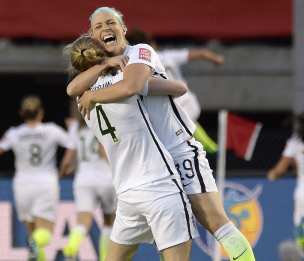 Julie Johnston, left, and Becky Sauerbrunn, celebrating a goal against China in the quarterfinals, are part of a confident United States team preparing for a semifinal showdown Tuesday against Germany as the world's top two ranked teams will meet.