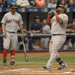 Boston Red Sox on-deck batter Mike Napoli, left, looks on as Pablo Sandoval scores after hitting a solo home run off Tampa Bay Rays starter Chris Archer in the second inning  Sunday in St. Petersburg, Fla.