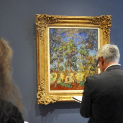 "People observe Van Gogh's ""Hospital at Saint-Remy"" at the Clark Art Institute in Williamstown, Mass. The exhibit, which runs through Sept. 13, features more than 40 artworks by Vincent Van Gogh."