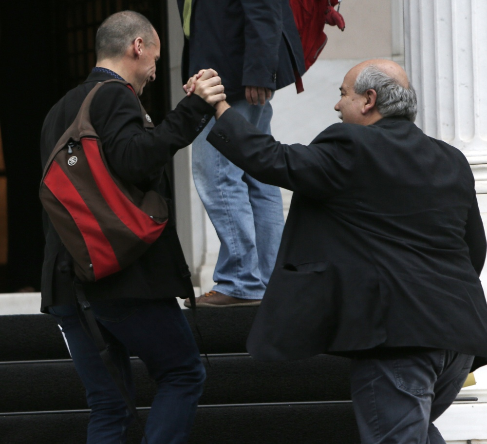 Greek Finance Minister Yanis Varoufakis, left, and Minister of Interior and Administrative Reconstruction Nikos Voutsis arrive in Athens for an urgent cabinet meeting Sunday.