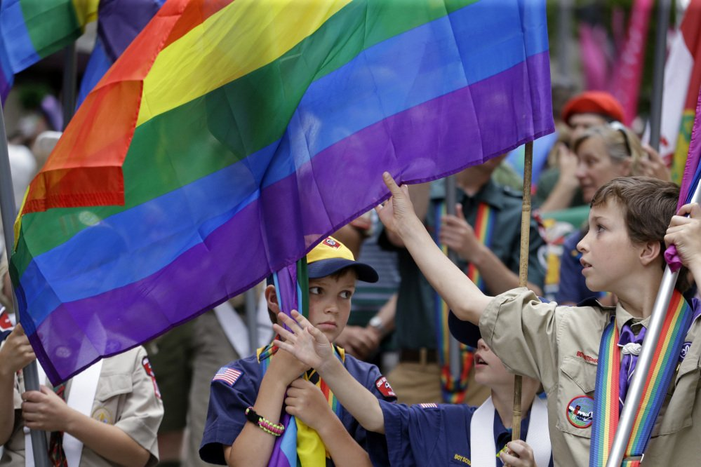 Scouts prepare their flags before leading marchers in the 41st annual Pride Parade on Sunday in Seattle.
