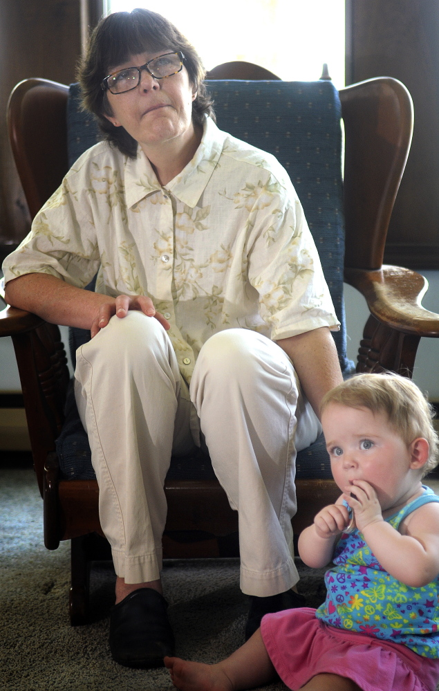 Donna Lufkin, of Gardiner, with Cheyenne, whom she has guardianship over, attends a meeting in Belgrade of the Augusta Area Kinship Support group for grandparents raising their grandchildren.